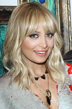 Long shag hair, fringe bangs. Pretty in golden blonde, maybe highlighted or light red