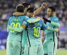 Barcelona's Argentinian forward Lionel Messi (10) is congratulated by Barcelona's Brazilian forward Neymar (R) and teammates after scoring their second goal during the Spanish league football match SD Eibar vs FC Barcelona at the Ipurua stadium in Eibar on January 22, 2017. / AFP / ANDER GILLENEA