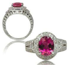 Amazing antique style, hand crafted diamond, pink tourmaline ring, containing 2.50ct oval briliant cut natural very fine quality pink tourmaline, surrounded by .50ct tw round brilliant cut pave set diamonds, set in 14kt white gold.
