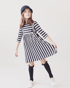 Can't get enough of the @anthemoftheants Scout dress! Pair it with some cool knee-socks for a perfect fall school outfit for your little lady! Now available at Amelia J Collection. Shop link in bio. #girls #girlsfashion #trendytots #trendykids #kidsfashion #igkids #ig_kids #instagood #instadaily #kidsfashion #dresses #girlsdresses