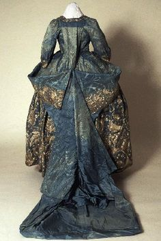 Court mantua and petticoat, Back view. Light blue satin damask heavily embroidered with silver thread. The mantua has been altered and most of the train has been cut away; the petticoat is unaltered. From the Morgan family of Tredegar Park, Monmouthshire. 18th Century Dress, 18th Century Costume, 18th Century Clothing, 18th Century Fashion, Vintage Outfits, Vintage Gowns, Vintage Mode, Vintage Fashion, Historical Costume