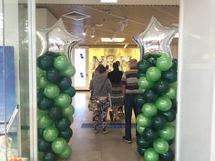 "Pearl lime green and forest Green balloon coloumn with a 36"" star as a feature"