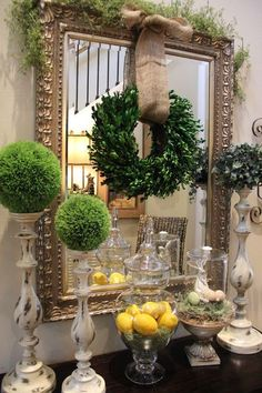 Simple boxwood wreath hung with burlap ribbon; evergreen balls rather than candles ~ Savvy Seasons by Liz