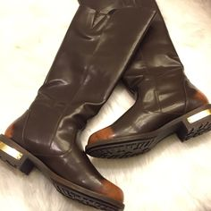 Leila stone riding boots Brand new Leila stone dark brown riding boots with a shade of orange in the back of the heel and the front. rusty gold hardware zipper.. Below the knee. $60 through mercari app Leila stone Shoes Combat & Moto Boots