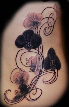 love the orchids different swirls and swirl design but those black orchids are to die for