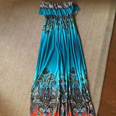 Strapless maxi dress. Size small Super comfy, flowy tube top,full length, maxi dress. Vibrant colors. Never worn only tried on. SIZE SMALL Dresses Maxi