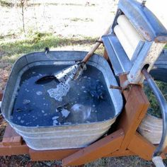Laundry day on the self-sufficient homestead includes two washtubs mounted on a frame with a hand-cranked wringer between them. It got the job done even for a family of six. - GRIT Magazine
