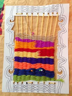 Paper frame loom, use hole puncher, add patterns and color to frame, then weave!