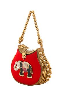 Metal bag with rawsilk fabric embellished with decorative elephant brooch from #Benzer #Benzerworld #bags #potlis #clutches