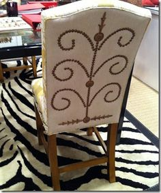 Nailhead design on Raymond Waites Counter Height Bench from Lane Venture.