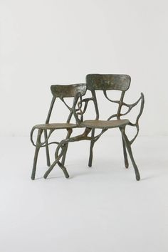 Intertwined Double Armchair - Anthropologie.com. Inspired by the energetic force that stems from trees, French sculptor Xavier Dumont creates functional, one-of-a-kind art that seems to have sprouted from the earth. Sculpted by hand, each piece recalls winding roots or reaching branches. Here, curling branches sprawl over a seat for two.