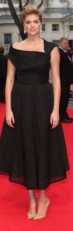 Kate Upton: Dress – William  Earrings – Adler  Shoes – Christian Louboutin