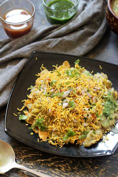 The spicy corn flakes masala puri with overloaded flavors of most of the spices in your kitchen and toppings like nylon sev and raw onion is just crazy.