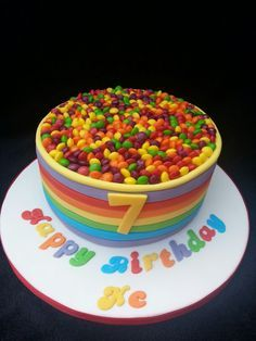 Skittles overload cake! Rainbow colours that i made for a 7yr old girl :)