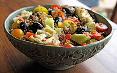 Quinoa Salad with black olives, cucumber, artichoke hearts, sweet peppers, cherry tomatoes and a simple vinaigrette