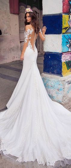 Beyond-romantic illusion sleeves and neckline. Sheer skirt with clean lines and tulle train create the most flawless look anyone could ask for. Fit and flare wedding dress   #wedding #weddingdress #weddinggown #bridedress