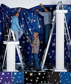 """These star patterned poly vinyls are a great way to transform your walls. The 58""""x200' roll would provide enough to cover walls and do the stage setup."""