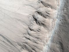 Geologists think that this textured terrain, which resembles features in the Colorado Plateau, formed when lava in the area cooled unusually quickly from flooding. For scale, the picture spans half a mile.