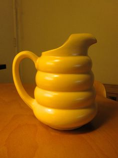 Vintage 30's Yellow Padre Pottery Ceramic Michelin Man Pitcher - VG Condition.