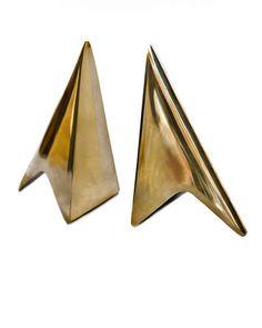 Trend: Lots of brass. Carl Aubock book ends from @Cooper-Hewitt store. #Brass #Metallic #Designtrend