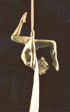 Ever since seeing Cirque De Soleil on Bravo I have been in love with this.  One day I hope to be strong enough to do this at Austin's Sky Candy!