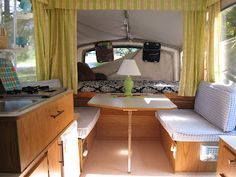 camper organization...hanging storage on the metal rods. Cute decor too!