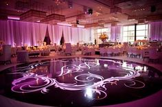 The dramatic monogrammed dance floor--4,482 square feet--from Platinum Pro. Total Entertainment handles entertainment