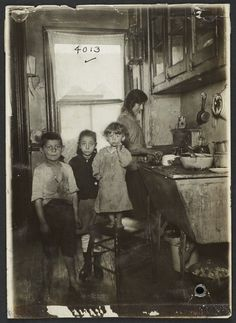Tenement family in the kitchen  New York 1915 - Back then...