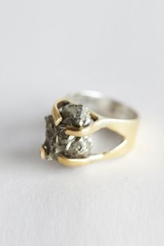 Stunning. Handmade ring of pyrite held in brass claw setting with a polished sterling silver inlay.