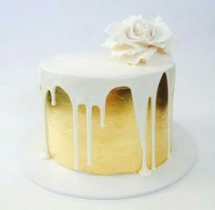 Gold leaf + white drizzle cake