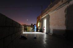 Vie de réfugié-e-s pendant le Ramadan : Des enfants de Homs jouent après l'iftar à Khalidiya, en Jordanie.