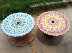 Salvaged wooden spools provide the perfect base for these mosaic patio tables.