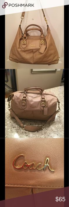 Coach shoulder bag with detachable shoulder straps Coach smooth TAN leather bag with gold hardware. In very good pre-loved condition. Interior spotless. Removable shoulder strap. Interior:  1 zip pocket and 2 open pockets. Purple interior. 15x8x6. Negotiable Coach Bags Hobos