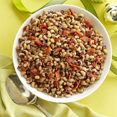 Black-Eyed Peas with Bacon Recipe -A real Southern favorite, black-eyed peas are traditionally served on New Year's Day to bring good luck. My mother's recipe with bacon, garlic and thyme makes them extra special. —Ruby Williams, Bogalusa, Louisiana
