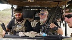 """Armed Patriots: Members of the """"Patriots"""" Huggie Bear (L, not his real name), Ray (C, no last name given) and Will (R, no last name given) patrol in their UTV near a camp of patriots near the U.S.-Mexico border outside Brownsville, Texas September 2, 2014. Huggie Bear, 25, is a former sergeant in the Army, Ray served six years in the Coast Guard and Will is a construction worker."""