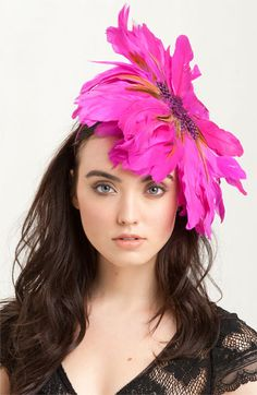 Not quite Lady Gaga and not quite Kate Middleton, this bold fascinator is sure to turn heads.  You'll definitely want to keep the rest of your ensemble low key...
