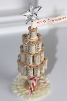 Spool Christmas Tree...I am going to use this same idea but with wine corks.