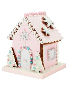 Inspired by the pretty pastel coloured houses found in West London, this luxury candy coloured gingerbread house is sure to delight anyone who sets eyes on it. With a heavenly scent of sugar and spice, each house has been painstakingly iced to perfection Cool Gingerbread Houses, Christmas Gingerbread House, Gingerbread Cookies, Christmas Cooking, Christmas Desserts, Christmas Treats, Pink Christmas Decorations, Barn Wedding Decorations, Biscuit Decoration