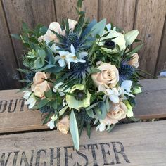 Spring Bridal Bouquet made with Mentha Roses, Paperwhites, Thistle and Black centred Anemone for a Bride at Farnham Castle