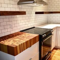 thick Canadian maple end grain top and walnut floating shelves with white gloss cabinets made and installed by Beamers Creek Woodworking. Butcher Block Countertops Kitchen, Cheap Countertops, Rustic Kitchen Cabinets, Kitchen Furniture, Kitchen Decor, Kitchen Ideas, Kitchen Planning, Real Kitchen, Kitchen White