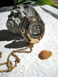 Off the Starboard Bow... Vintage octopus illustration in brass porthole necklace