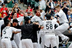 Gordon Beckham #15 of the Chicago White Sox leaps into the air as he laands on home plate after hitting a walkoff home run against the Texas Rangers during the eleventh inning at U.S. Cellular Field on June 21, 2015 in Chicago, Illinois. The Chicago White Sox won 3-2 in eleven innings.