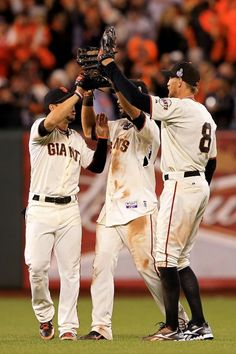 Gregor Blanco #7, Angel Pagan #16 and Hunter Pence #8 of the San Francisco Giants celebrate after they won 2-0 against the Detroit Tigers during Game Two of the Major League Baseball World Series at AT & T Park on October 25, 2012 in San Francisco, California
