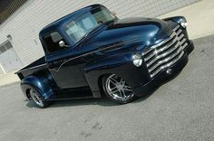 Custom '54 Chevy Pickup. dig the dark blue metallic. ~~ I don't think this is a 1954 but perhaps a year or two earlier. Nevertheless an awesome styled pick up truck.