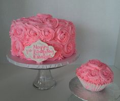 8 inch French buttercream Rose covered cake with a Jumbo Rose covered smash cupcake. Cake Art designs by Marie