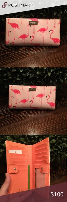 NWT Kate Spade Stacy Wallet♠️ NWT Super cute flamingo print authentic Kate Spade wallet. Price is pretty much firm for now as I'm still not sure if I want to let it go❤️ kate spade Bags Wallets