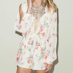 Floral Split Sleeve Tie Front Romper A super cute one piece that you will love all Spring long! This piece has floral print throughout with cut out at bust; with tie up detailing. Also has cinched waist line. Pair with gladiator sandals and a tote! Polyester Made in USA Model wearing size small Runs true to size Hand wash cold Pants Jumpsuits & Rompers