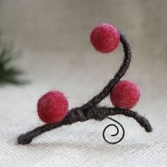 Carefully hand felted red berry beads and wool covered wire turn into a wonderful winter themed brooch, pin, ornament or home decoration.