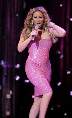 Pin for Later: See the Stars Fighting For a Breast Cancer Cure  Mariah Carey belted it out on stage at London's Tickled Pink charity concert in September 2005.