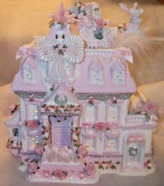 Lighted shabby chic style Christmas village house complete with santa and his sleigh on the roof :)  May be purchased at my ebay sight - katsdecor4u